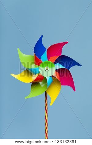 Colorful pinwheel isolated on blue background