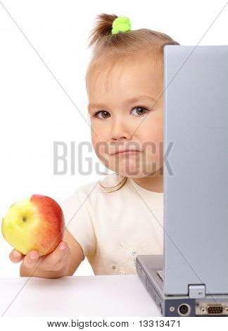Cute Little Girl With Laptop And Apple