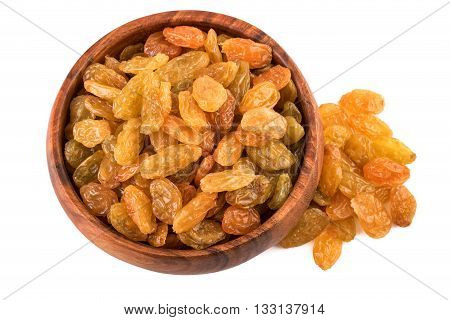 Raisins in wooden cup on white background. Top view.