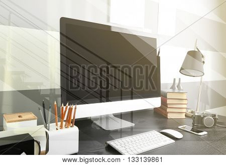 Open space office workplace view through glass with reflection