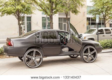 DALLAS USA - APR 8: Custom Chevrolet Impala on 28 Inch Wheels in the city of Dallas. April 28 2016 in Dallas Texas United States