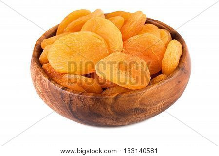 Dried apricots in wooden cup isolated on white background.