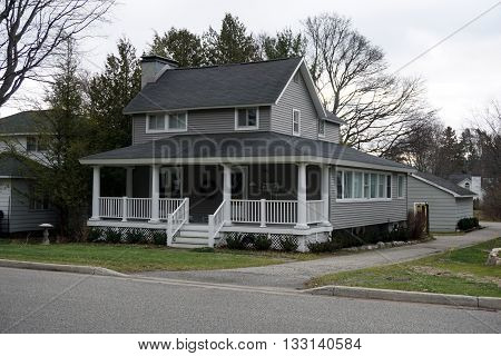HARBOR SPRINGS, MICHIGAN / UNITED STATES - DECEMBER 24, 2015: A gray Victorian home on Fourth Street in Harbor Springs.