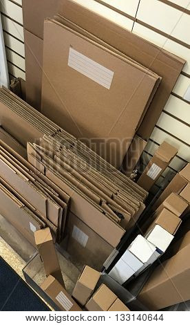 Cardboard packing and shipping boxes and materials.