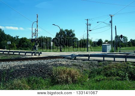 PLAINFIELD, ILLINOIS / UNITED STATES - SEPTEMBER 20, 2015: A railroad crossing near downtown Plainfield, Illinois.