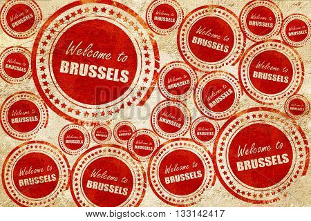 Welcome to brussels, red stamp on a grunge paper texture