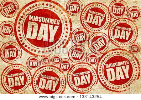 midsummer day, red stamp on a grunge paper texture