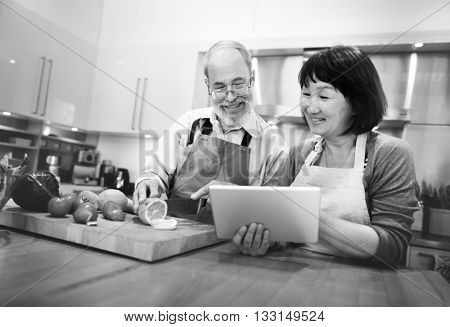 Husband Wife Cooking Searching Menu Tablet Concept