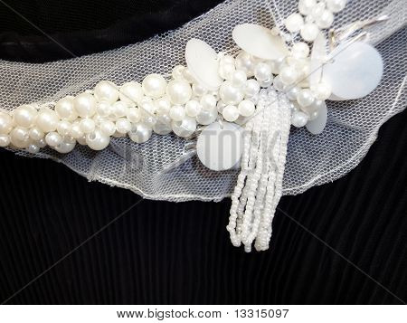 White beads on black cloth
