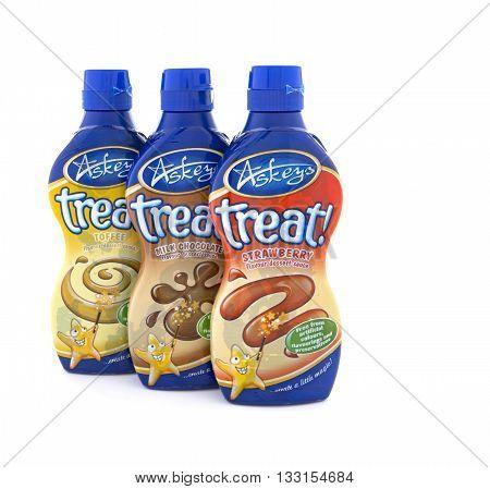 SWINDON UK - JUNE 3 2016: 3 Bottles of Askeys Treat Desert Sauce on a white background