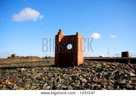 Strange Rusty Rail Construction With Hole