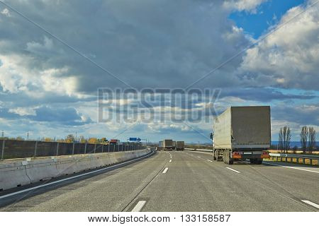 Driving on a highway with truck in front
