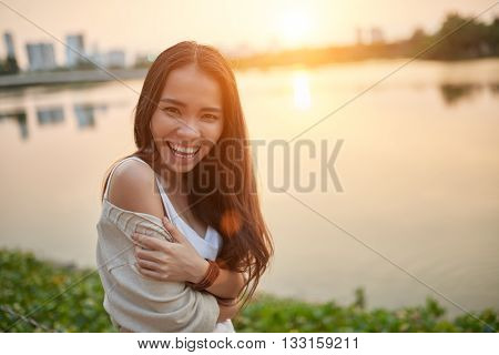 Portrait of beautiful Asian woman standing at the lake