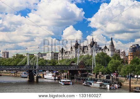 LONDON UNITED KINGDOM - 23 MAY 2016: Jubilee bridge Big Ben and Westminster Abbey in London United Kingdom