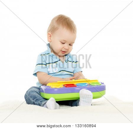 Little  child is playing with developing toy on a white background.