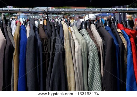 Used and already worn clothes at a flea market