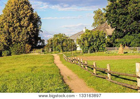 Footpath to home in the Mikhailovskoye village autumn sunset. Pushkinskiye Gory Reserve Russia