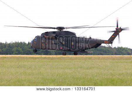 BERLIN / GERMANY - JUNE 3 2016: Sikorsky S-65 CH-53 transport helicopter flies in berlin germany on june 3 2016.