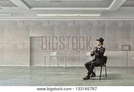 Businessman in cylinder drinking coffee