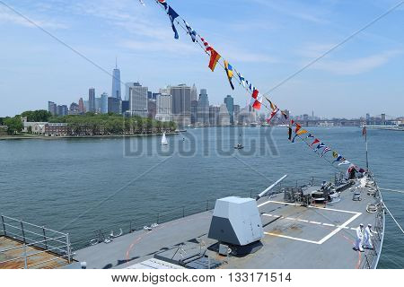 NEW YORK - MAY 26, 2016: US Navy guided-missile destroyer USS Bainbridge docked in Brooklyn Cruise Terminal during Fleet Week 2016 in New York. Manhattan Sky Line on the background