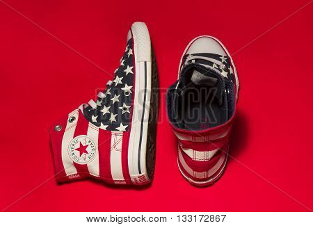 Dnipropetrovsk Ukraine - May 29 2016: All Star Converse sneakers on red background