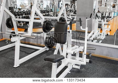 Closeup of two weightlifting training devices at gym. Front view on two special training devices for weightlifting. Weightlifting training equipment opposite mirror at gym