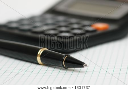 Pen And Calculator With Shallow Depth Of Field