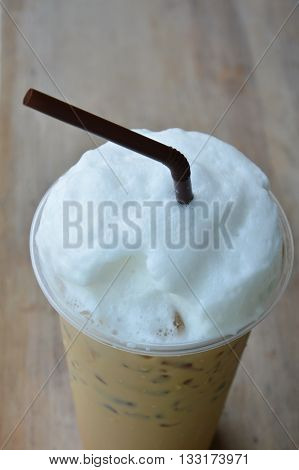 latte and milk froth in plastic cup