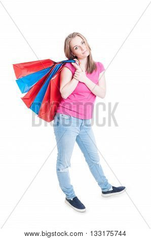 Beautiful Young Woman Carrying Paper Bags In Her Back