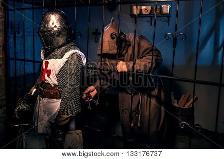 Ancient knight and monk prisoner in castle