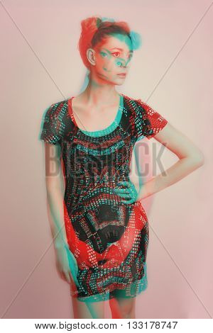 Studio portrait of young woman with colorful 3d effects