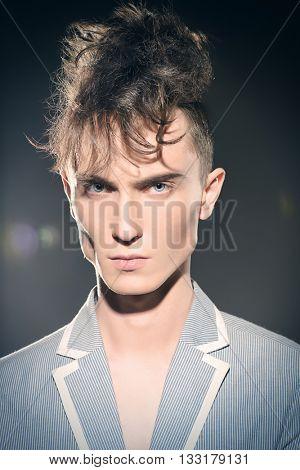 Fashion male model with stylish upright hair. Beauty, fashion.