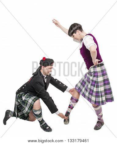 Man In Kilt Teaching Woman Scottish Dance