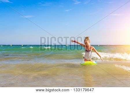 Cute Girl In Swimsuit Bathes On Waves In Sea. Sunny Mediterranean Beach, Cala Del Palangre, Torrevie