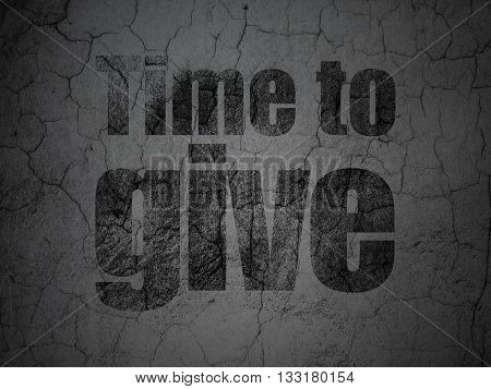 Time concept: Black Time To Give on grunge textured concrete wall background