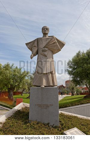 PORTO PORTUGAL - MAY 26 2016: Statue of Antonio Ferreira Gomes (1979 architect Arlindo Rocha) in Porto (UNESCO site). Gomes (1905-1989) was bishop of Portalegre (1949-1952) and of Porto (1952-1982)