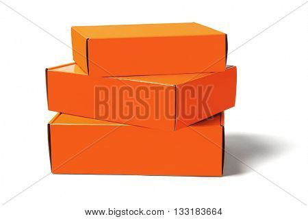 Stack of Three Orange Boxes on White Background
