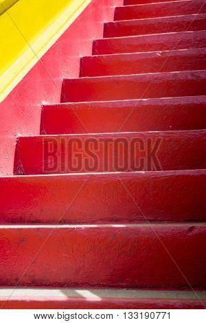 Detail of a red and yellow mediterranean staircase. Mediterranean architectural concept.