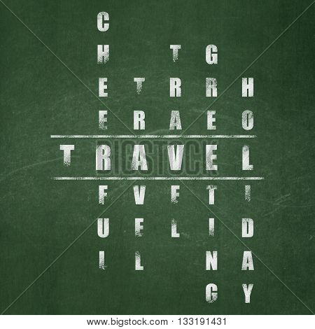 Holiday concept: Painted White word Travel in solving Crossword Puzzle on School board background, School Board