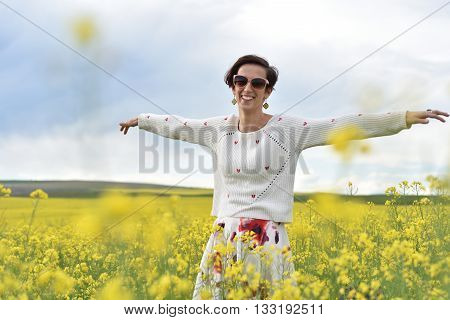 Happy Woman Cheering In Canola Field In The Summer