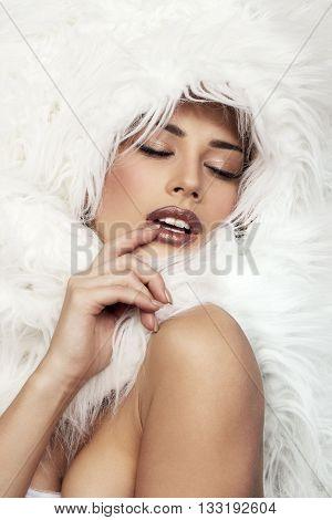 Sexy Russian girl in fur in photo studio