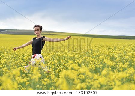 Young Woman Cheering In Canola Field In The Summer