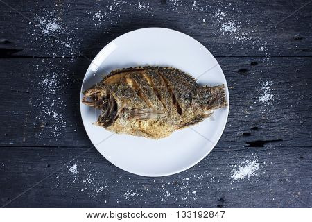 Deep Fried Tilapia Fish with salt Top view.