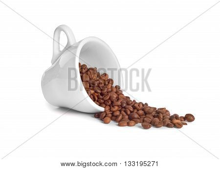 coffee beans poured from a cup on white