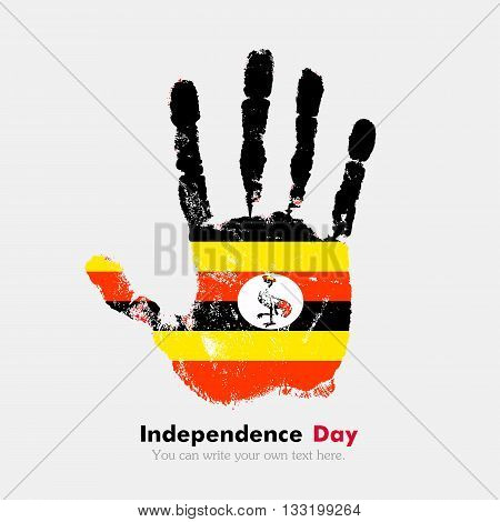 Hand print, which bears the Flag of Uganda. Independence Day. Grunge style. Grungy hand print with the flag. Hand print and five fingers. Used as an icon, card, greeting, printed materials.