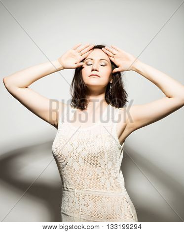 close-up portret of beautiful young brunette woman in a transparent dress posing and expresses different emotions.