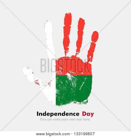 Hand print, which bears the Flag of Madagascar. Independence Day. Grunge style. Grungy hand print with the flag. Hand print and five fingers. Used as an icon, card, greeting, printed materials.