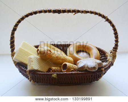 different sweet pastries in a basket, the assortment of confectionery products