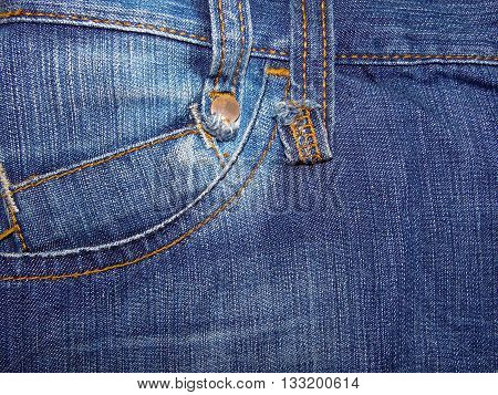 Blue denim pocket with overdue seams, close up