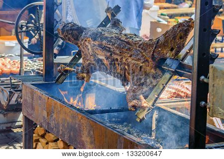 a whole lamb roasted on a spit, in the Hutsul region in Western Ukraine